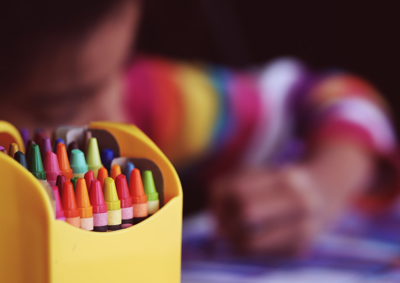 crayons and kid coloring